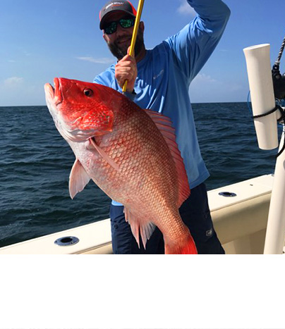 Fisherman holding a red snapper on a boat and out at sea